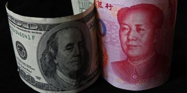 کاهش ارزش برابری یوآن در معاملات بازارهای جهانی
